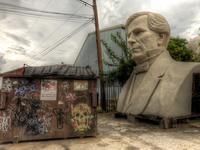 President-bust-and-dumpster-